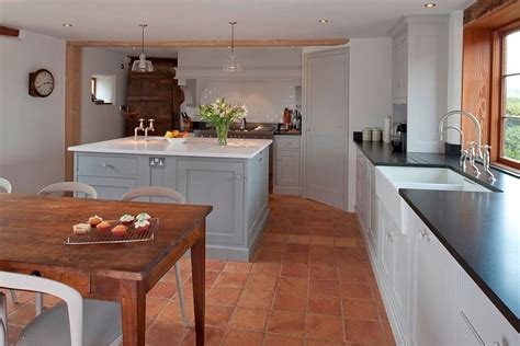 country style kitchens designs 20 interiors that embrace the warm rustic of terracotta tiles