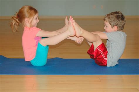 boat pose holding toes snowga wintertime yoga for kids the inspired treehouse