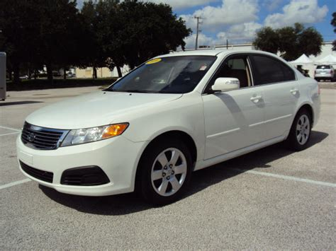 Kia Optima Four Wheel Drive Kia Optima 2009 Wht Sedan Gasoline 4 Cylinders Front Wheel