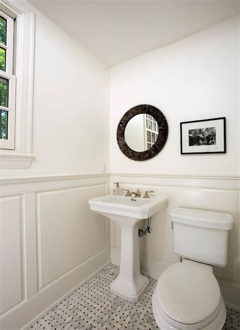 four brothers llc monochromatic bathroom with wainscoting and white paint color marble