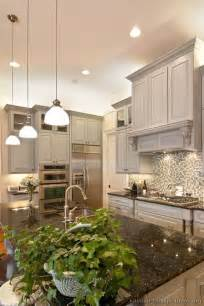 ceiling high kitchen cabinets lovely gray kitchen with island pendant lights a wood a glass tile backsplash and high
