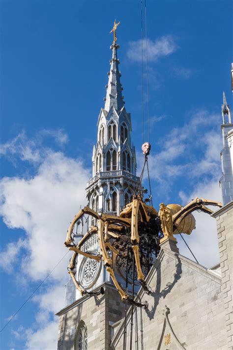 lamachine spider atop notre dame cathedral ottawa