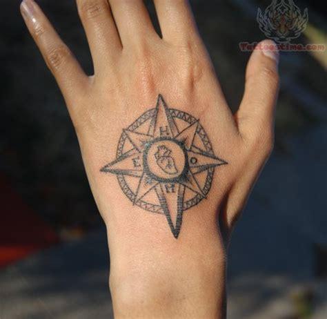 finger tattoo compass compass tattoo on hand