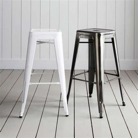 tolix metal bar stools tolix tall metal bar stools originally designed by xavier pauchard in 1934 for a range of caf 233