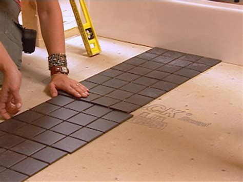 how to lay tile in the bathroom laying tile floor in bathroom wood floors