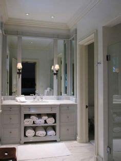 vanity with towel storage with the builder grade vanity doors on