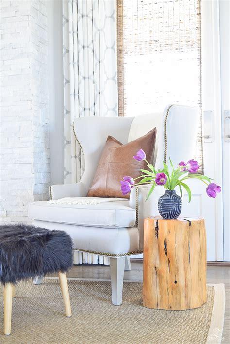 Black Leather Wingback Chair Design Ideas White Leather Wingback Chair With Brass Nail Heads Black Furt Stool Stump Sidetable Blue