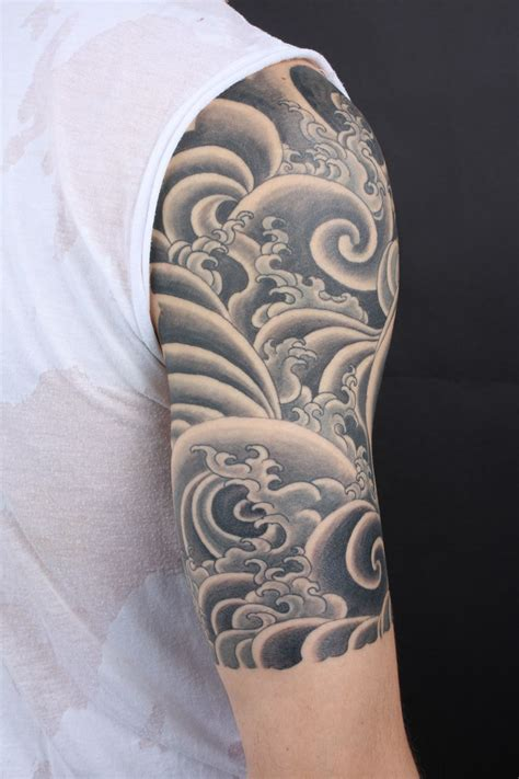 nepalese tattoo designs black and gray water half sleeve tibetan style wave