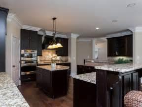 Light granite espresso cabinets and light granite countertops on