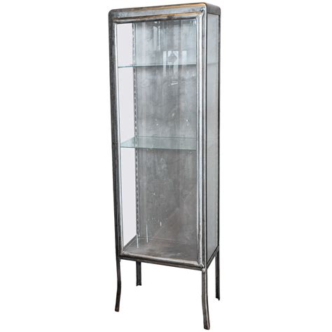 1930s Glass Display Cabinet by A 1930s Wrought Iron And Glass Display Cabinet