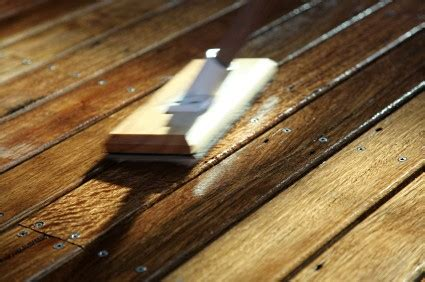 apply deck stain   roller  pad  house