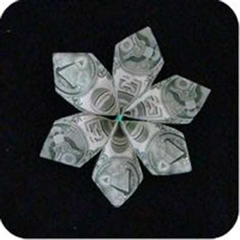 Folding Paper Money Into Flowers - 10 ideas about money flowers on money bouquet