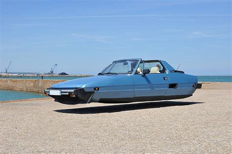 automobile volante sylvain viau s flying cars hover beside the seaside