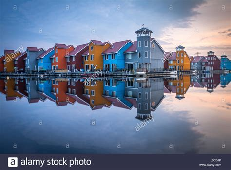 free photo fireworks groningen netherlands free image colorful houses reflected in the water in groningen