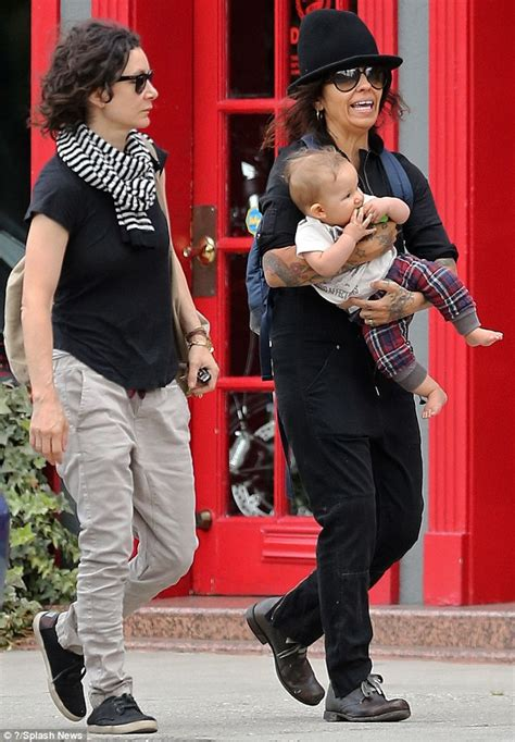 linda perry on the view sara gilbert strolls with wife linda perry and their son