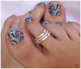 Minty nail polish base layer with floral design on a top