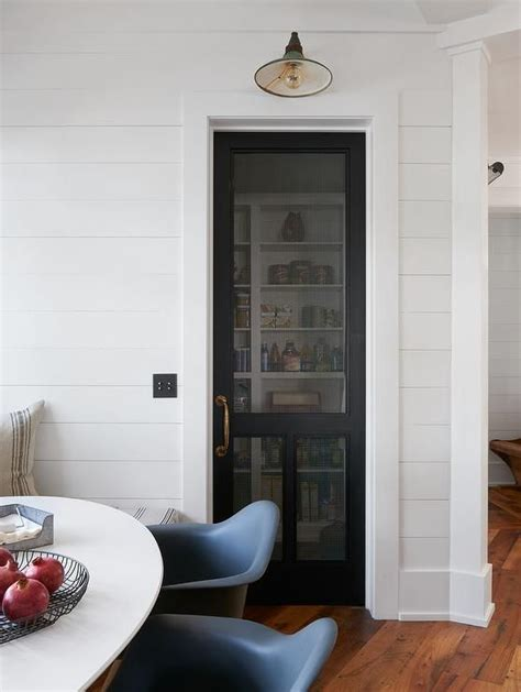 cottage kitchen boasts  shiplap wall fitted   black