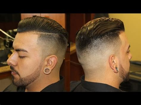 view from back of pompadour hair style slicked back pompadour with bald fade pomp scissor