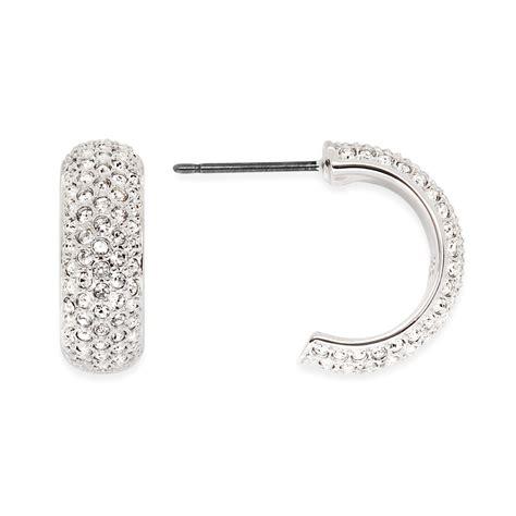 swarovski huggie hoop earrings in silver lyst