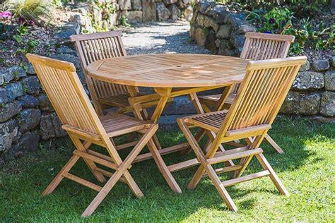 Teak garden table and chair set   Garden Furniture Land