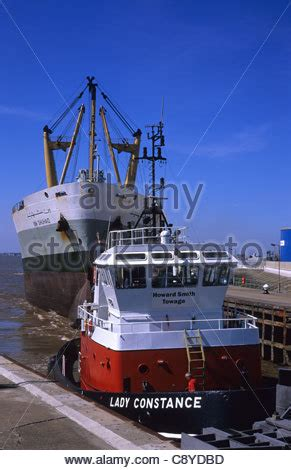 towing a boat into the us tug boat towing freighter into lock at the port of hull