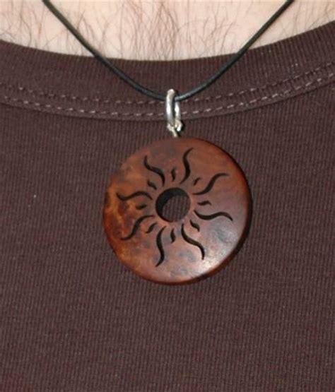 wooden sun pendant closeup of the wooden pendant