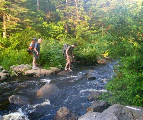 fording a river fording a river section hikers backpacking