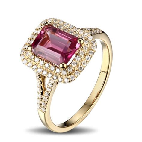 2 carat ruby and halo engagement ring in yellow