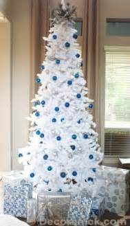 white christmas tree with blue and silver decorations