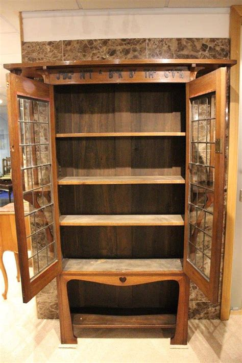 oak arts and crafts liberty s style bookcase with motto at