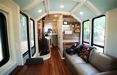 live off grid travel in this beautiful tiny home caravan traveling family raises the roof on this brilliant off