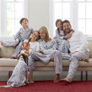 Family matching winter pajamas party penguins