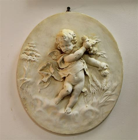 The Dealer Cherub found in ithaca 187 vintage cherub plaque