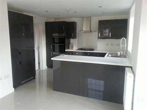 charcoal grey gloss kitchen units white worktops  grey