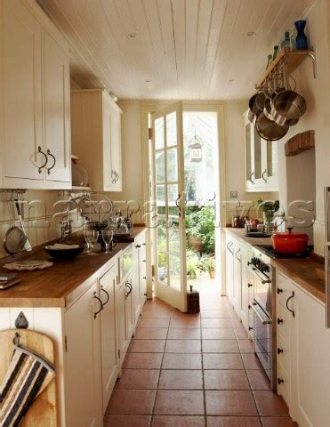 Narrow Galley Kitchen Ideas | bd020 04 narrow galley kitchen with door opening onto