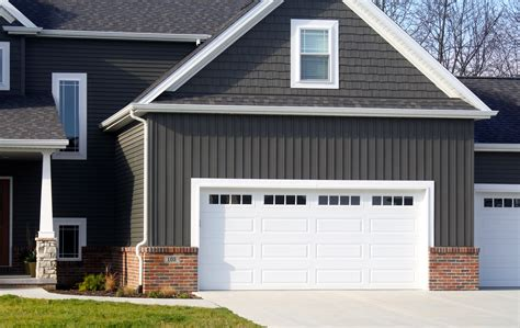 Amazing Garage Doors Maintenance Services #1: White-long-panel-raised-panel-garage-door-with-mission-window-inserts-in-downs-il.jpg