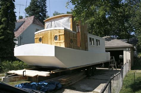 Handmade Houseboats - kalamazoo isn t noah but he s building a boat in his