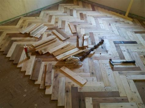pallet wood flooring diy 25 best ideas about wood pallet flooring on building a porch pallet floors and