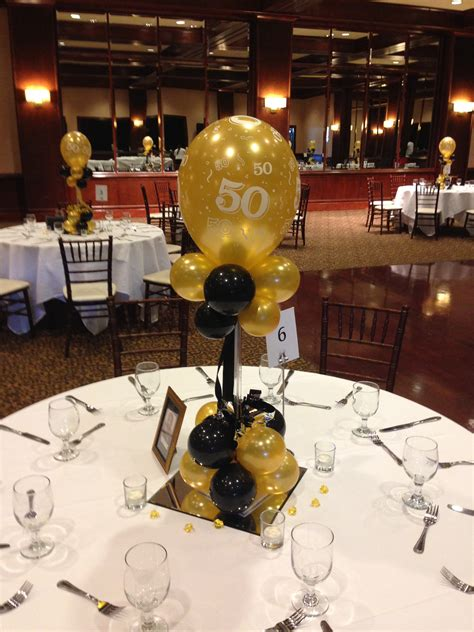 gold themes name black and gold balloon centerpieces for a 50th birthday or