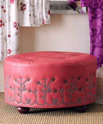 upholstery nail heads nailhead ottomon would be cool as black and silver home