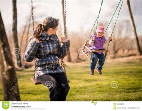 mom swings baby around swinging together mother and baby stock photo image