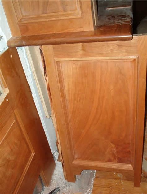 cutting kitchen cabinet end panels installing cherry cabinet end panels abutting paneling