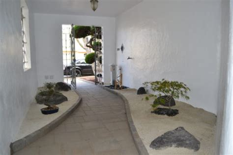 foyer zen zen indoor outdoor entryway drought tolerant landscape