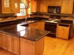 Kitchen on pinterest oak cabinets oak kitchen cabinets and granite