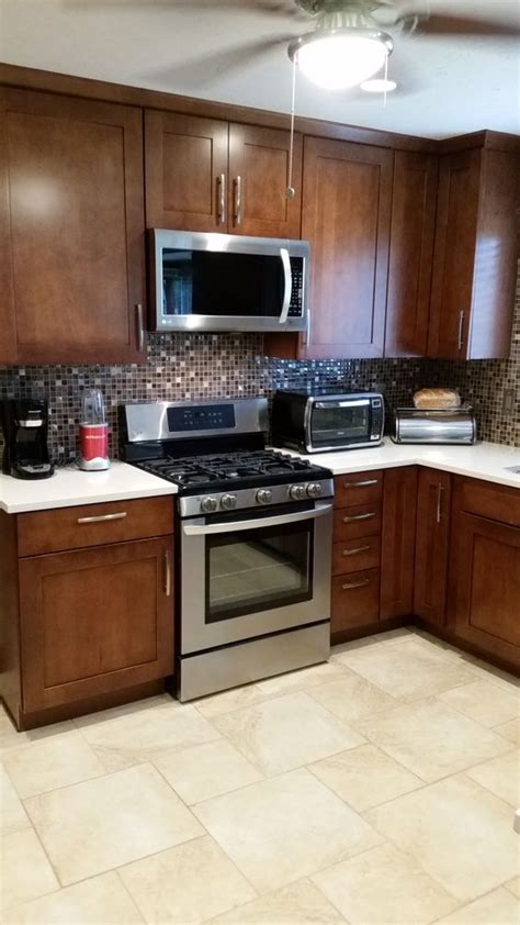my finished kitchen lg gas range kraft cabinets