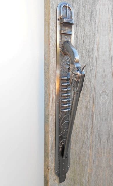 gun door handle gun door handle pistol door pull mounted on cartridge belt cast in bronze antique nickel