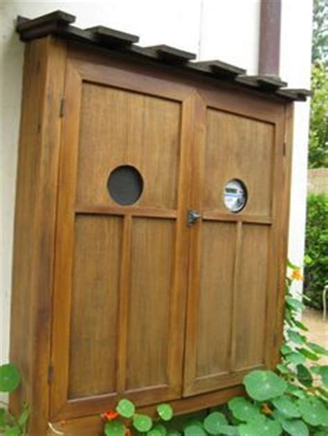 Decorative Outdoor Electrical Box Covers by How To Aesthetically Hide An Electric Meter Box Hanging On