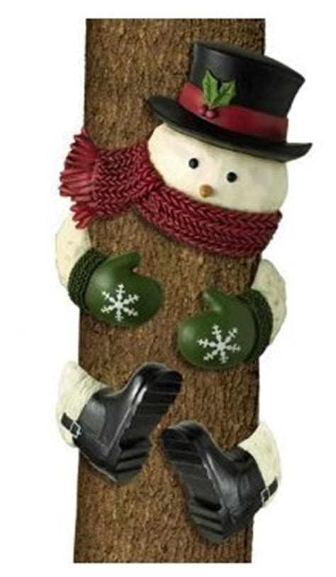 how to make a snowman tree hugger outdoor statues cheap grasslands road winter snowman with top hat outdoor tree hugger