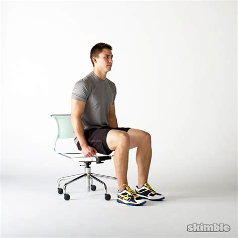 chair leg raise at home seated knee raises exercise how to workout trainer by