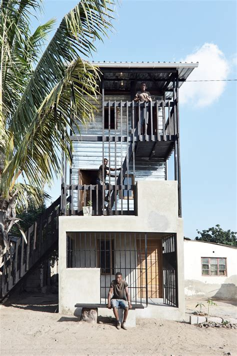 Low cost house in Mozambique features corrugated iron and